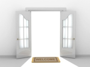 welcome-mat-in-front-of-open-doors